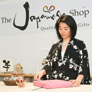 Hiromi wrapping gifts in showroom