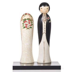 Bride and groom Japanese kokeshi dolls in western wedding attire