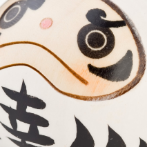 White Happiness Daruma Kokeshi Doll Close Up